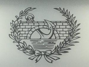 Escudo de la ETSICCP, UPM. Archivo IAEA.